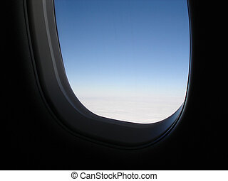 Airplane Window - View of an airplane window from inside.