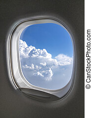 Airplane window with picture of sky cloudy aerial view.