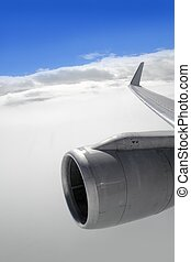 airplane wing aircraft turbine flying blue sky white clouds