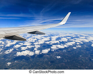 Airplane in flight, wing view