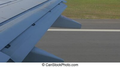 Airplane wing during takeoff on runway