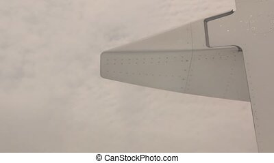 Airplane Wing Engine Above Clouds