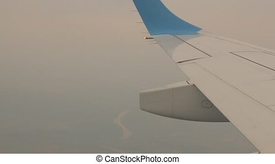 Airplane Wing In The Fog