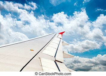 airplane wing, sky and clouds