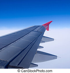 Airplane wing - View out of airplane Airplane wing in flight...