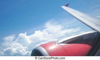 airplane wing turbine, passenger porthole - Flying above...