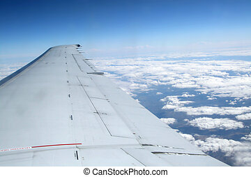 View of long airplane wing from window