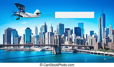 airplane with a banner - old airplane with a banner in the...