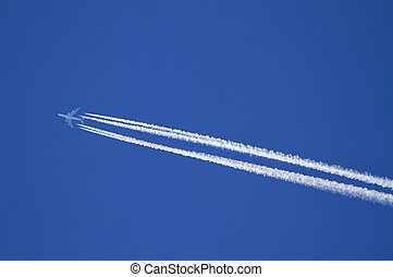 Airplane with condensation trails.
