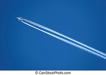 Airplane with contrail - An Airplane with contrail high in...