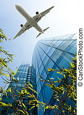 airplane with modern building. Jet over City