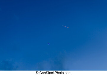 airplane with moon and sky