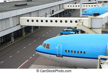 Airplanes at the Airfield - Airplanes parked at the gates to...