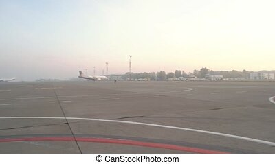 Airplanes at the airport. International airport in a foggy morning. Travel and transportation cocept.