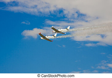airplanes flying at aviation show. blue sky background