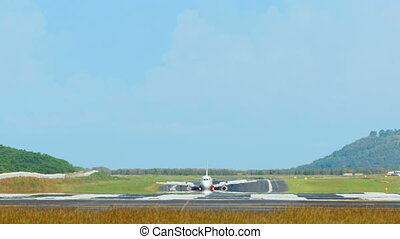 Airplanes taxiing - PHUKET, THAILAND - NOVEMBER 28, 2014:...
