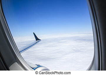 Airplpane windows. Beautiful view of sky and clouds