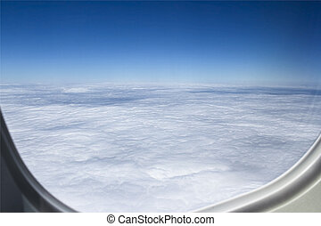 Airplpane windows. Beautiful view of sky and clouds.