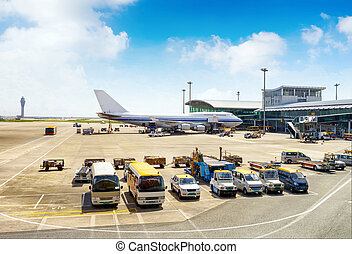 Airport - A passenger plane being serviced by ground ...