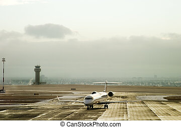 Airport Activity - An airplane taxiing on the tarmac of an ...