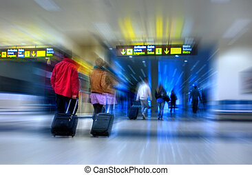 Airport - Airline passengers walking in the airport terminal