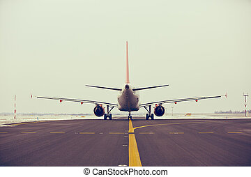 Airport - Airplane is taxiing on the airport in winter.