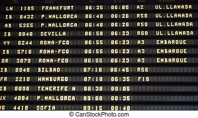 Airport boarding board in Spain - Closeup of airport...