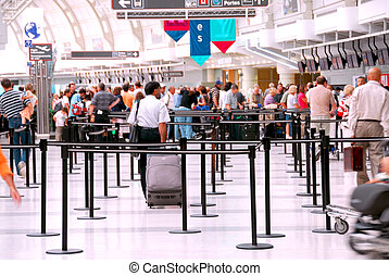 Passengers lining up at check-in counter at the modern international airport