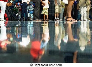Airport crowd - Legs of people in airport departure hall,...