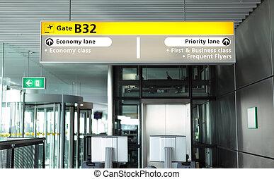Airport departure gate - Departure boarding gate inside a...