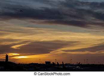 Airport during sunset with takeoff airplane airport boarding