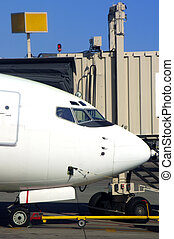 Airport Gate - Aircraft Parked At The Loading Gate At An...
