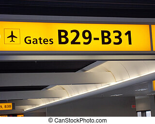 Airport gate sign.
