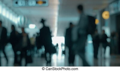 Airport hall with walking people, defocus