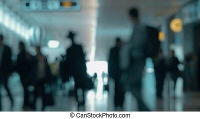 Airport hall with walking people, defocus