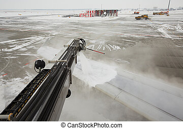 Airport in winter - Deicing of the airplane