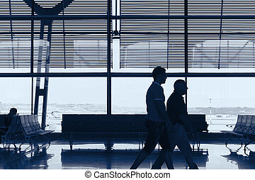 Airport indoor with people. Travel tourism background.