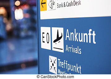 Airport information sign - Brightly light arrival airport...