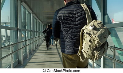 Airport jetway terminal - Man on the jetway terminal to...
