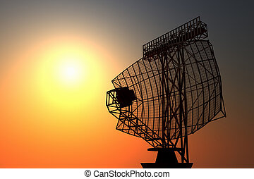 An airport surveillance radar black silhuette on a setting sky background.