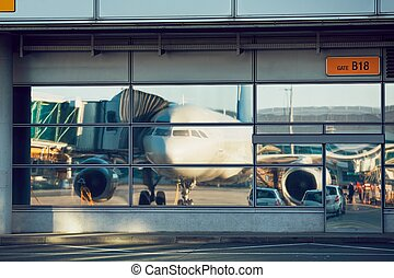 Airport reflections during sunny day