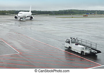 Airport runaway with airplane on a rainy day. Travel