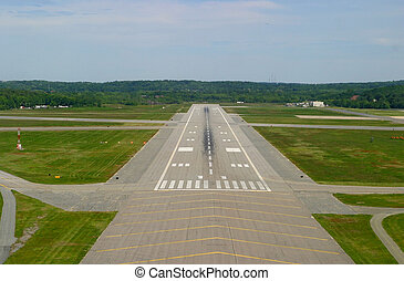 Airport runway on landing approach. Taken from cockpit of small private plane.