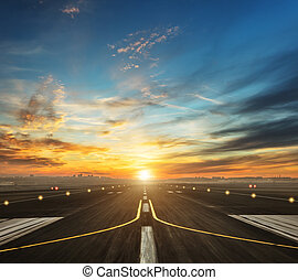 airport runway in the evening sunset light, ready for...
