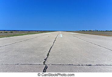 Airport Runway - old airport runway under blue sky
