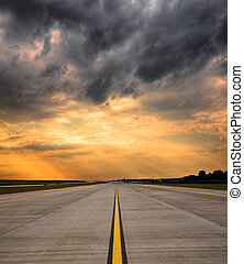 Airport runway on sunset