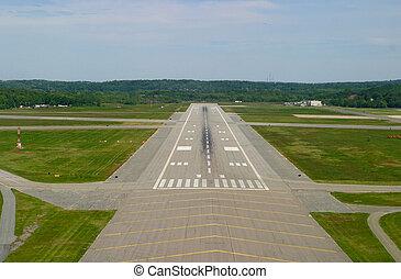 Airport Runway - Airport runway on landing approach. Taken...