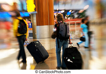 Airport rush - People rushing in an airport. Shot with a...