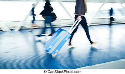 Airport rush: people with their suitcases
