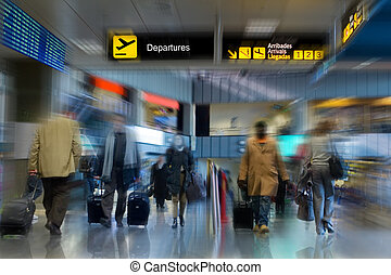 Airport Terminal - Airline passengers walking in the airport...